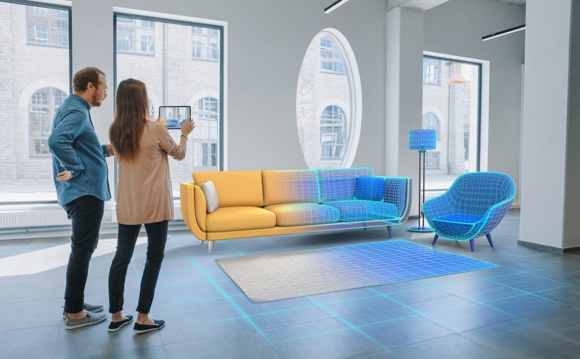 Decorating Apartment: Lovely Young Couple Use Digital Tablet with Augmented Reality Interior Design Software to Choose 3D Furniture for their Home. People Pick Sofa, Table and Lighting for Living Room